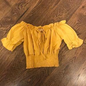 A super cute off the shoulder mustard shirt